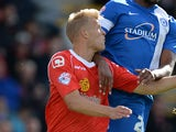 Harry Davis of Crewe Alexander challenges Tyrone Barnett of Peterborough United during their Sky Bet League One match at the Alexandra Stadium on September 7, 2013
