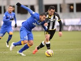 Ivan Piris (R) of Udinese Calcio competes with Carlos Tevez of Juventus FC during the Serie A match at Stadio Friuli on February 1, 2015