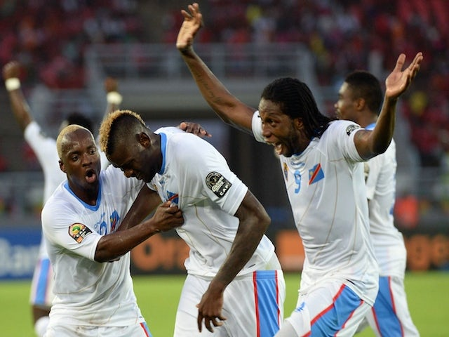 Democratic Republic of the Congo's forward Jeremy Bokila (C) is congratulated by teammates after scoring a goal during the 2015 African Cup of Nations quarter final football match against Congo on January 31, 2015