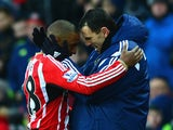 Jermain Defoe of Sunderland embraces Manager Gustavo Poyet of Sunderland during the Barclays Premier League match against Burnley on January 31, 2015