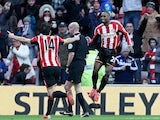 Jermain Defoe (R) celebrates after scoring his team's second goal during the English Premier League football match against Burnley on January 31, 2015