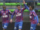 Caen's French midfielder Julien Feret (C) is congratulated by teammates after scoring a goal during the French L1 football match between Caen (SMC) and Saint-Etienne (ASSE) on February 1, 2015