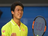 Kei Nishikori of Japan celebrates winning in his fourth round match against David Ferrer of Spain during day eight of the 2015 Australian Open at Melbourne Park on January 26, 2015