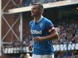 Lee McCulloch of Rangers runs off to celebrate after scoring during the Scottish Championship League Match between Rangers and Dumbarton, at Ibrox Stadium on August 23, 2014