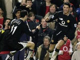 Cristiano Ronaldo of Manchester United is congratulated by Ryan Giggs after scoring their second goal of the game during the Barclays Premiership match between Arsenal and Manchester United at Highbury on February 1, 2005