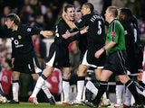 John O'Shea of Manchester United is congratulated by team mates after scoring the fourth goal for United, during the Barclays Premiership match between Arsenal and Manchester United at Highbury on February 1, 2005