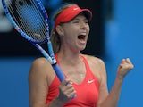 Russia's Maria Sharapova celebrates after victory in her women's singles match against Canada's Eugenie Bouchard on day nine of the 2015 Australian Open tennis tournament in Melbourne on January 27, 2015
