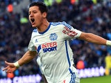 Marseille's French midfielder Florian Thauvin reacts after attempting to scored during the French L1 football match between Marseille and Evian Thonon Gaillard, on January 31, 2015