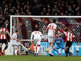 Grant Leadbitter of Middlesbrough scores from the penalty spot past David Button the Brentford goalkeeper during the Sky Bet Championship match between Brentford and Middlesbrough at Griffin Park on January 31, 2015