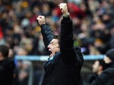 John Carver, manager of Newcastle United celebrates his team's third goal during the Barclays Premier League match between Hull City and Newcastle United at KC Stadium on January 31, 2015