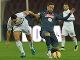 Nicolas Burdisso of Genoa and Gonzalo Higuain of Napoli in action during the Serie A match between SSC Napoli and Genoa CFC at Stadio San Paolo on January 26, 2015