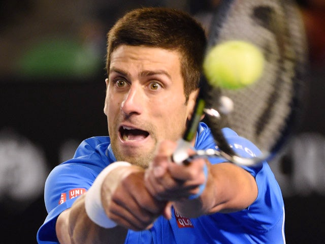 Serbia's Novak Djokovic plays a shot during his men's singles match against Luxembourg's Gilles Muller on day eight of the 2015 Australian Open tennis tournament in Melbourne on January 26, 2015