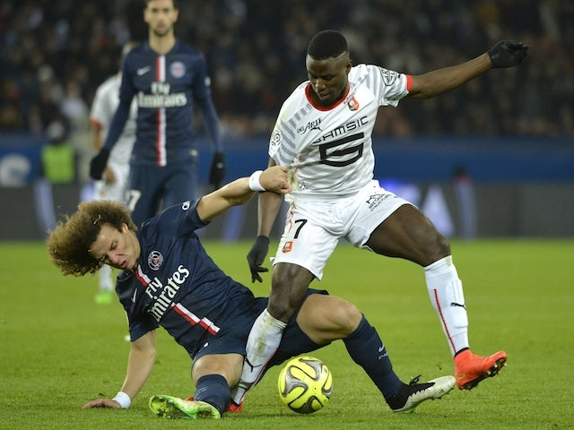 Rennes' French forward player Paul-Georges Ntep (R) vies with Paris Saint-Germain's Brazilian defender David Luiz during the French L1 football match on January 30, 2015