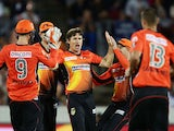 Brad Hogg of the Scorchers celebrates with team mates after taking the wicket of Jordan Silk of the Sixers during the Big Bash League final match between the Sydney Sixers and the Perth Scorchers at Manuka Oval on January 28, 2015