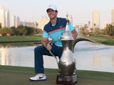 Rory McIlroy of Northern Ireland poses with the winners trophy after winning the final round of the 2015 Omega Dubai Desert Classic on February 1, 2015
