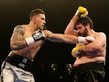 Sonny Bill Williams throws a right at Chauncy Welliver during their heavyweight bout during the Footy Show Fight Night at Allphones Arena on January 31, 2015