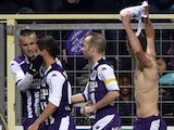 Toulouse's Serbian forward Aleksandar Pesic holds up his jersey as he celebrates with teammates after scoring during the French L1 football match Toulouse against Reims on January 31, 2015