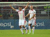 Tunisia's forward Ahmed Akaichi celebrates with Tunisia's defender Aymen Abdennour after scoring a goal during the 2015 African Cup of Nations quarter-final football match between Equatorial Guinea and Tunisia in Bata on January 31, 2015
