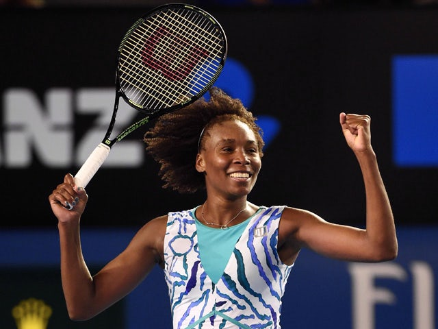 Venus Williams of the US celebrates after victory in her women's singles match against Poland's Agnieszka Radwanska on day eight of the 2015 Australian Open tennis tournament in Melbourne on January 26, 2015