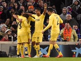 Villarreal's players celebrates after scoring a goal during the Spanish league football match FC Barcelona vs Villarreal CF at the Camp Nou stadium in Barcelona on February 1, 2015