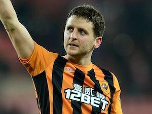 Alex Bruce rejoins Wigan Athletic