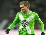 Wolfsburg's midfielder Andre Shuerrle runs with the ball during the German first division Bundesliga football match VfL Wolfsburg vs 1899 Hoffenheim in Wolfsburg, central Germany, on February 7, 2015