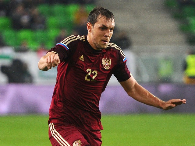 Russia's forward Artyom Dzyuba kicks teh ball during a friendly football match Hungary vs Russia at Groupama Arena in Budapest on November 18, 2014