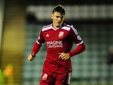 Ben Gladwin of Swindon Town in action during the Johnstone's Paint Trophy second round match between Plymouth Argyle and Swindon Town at Home Park on October 7, 2014
