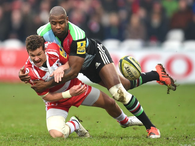 Billy Burns of Gloucester and Ugo Monye of Harlequins battle for the ball during the LV=Cup match on February 7, 2015