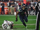 Bruce Irwin of the Seattle Seahawks reacts after sacking quarterback Tom Brady of the New England Patriots during Super Bowl XLIX February 1, 2015