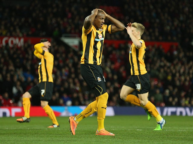 Tom Elliott of Cambridge United after hitting the post during the FA Cup Fourth round replay match between Manchester United and Cambridge United at Old Trafford on February 3, 2015