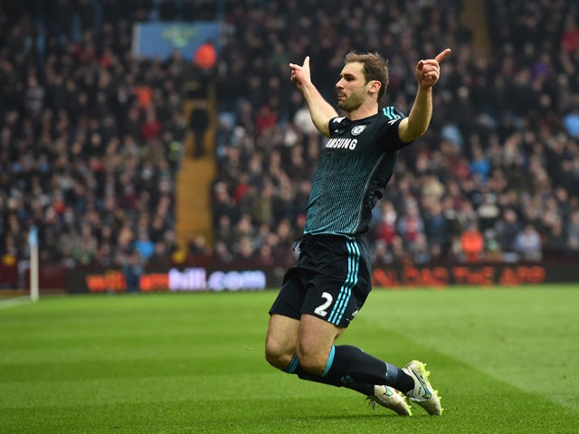 Chelsea's Serbian defender Branislav Ivanovic celebrates after scoring their second goal during the English Premier League football match between Aston Villa and Chelsea at Villa Park in Birmingham, central England on February 7, 2015