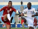 Equatorial Guinea's midfielder Emilio Nsue (L) challenges Democratic Republic of the Congo's defender Cedric Mongongu during the 2015 African Cup of Nations third place play-off match on February 7, 2015