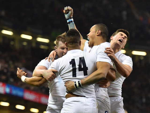 England's wing Anthony Watson celebrates with team-mates after scoring a try during the Six Nations international rugby union match between Wales and England at the Millennium Stadium in Cardiff, south Wales, on February 6, 2015
