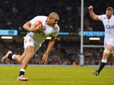 England's centre Jonathan Joseph scores a try during the Six Nations international rugby union match between Wales and England at the Millennium Stadium in Cardiff, south Wales, on February 6, 2015