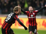 Frankfurt's midfielder Stefan Aigner celebrates scoring the 1-0 during the German first division Bundesliga football match Eintracht Frankfurt vs VfL Wolfsburg at the Commerzbank Arena in Frankfurt am Main, western Germany on February 3, 2015