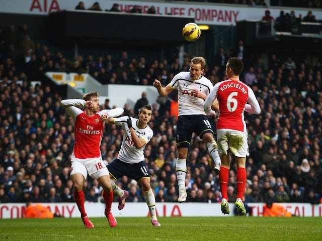 Harry Kane of Tottenham Hotspur heads the winning goal during the Barclays Premier League match against Arsenal at White Hart Lane on February 7, 2015