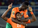 Ivory Coast's defender Serge Wilfried Kanon celebrates with defender Eric Bailly (back) after scoring his team's third goal during the 2015 African Cup of Nations semi-final football match between Democratic Republic of the Congo and Ivory Coast in Bata o