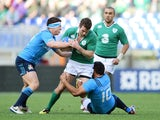 Jared Payne of Ireland is tackled by Luca Morisi (L) of Italy and Kelly Haimona (R) of Italy during the RBS Six Nations match on February 7, 2015