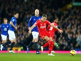 Jordan Henderson of Liverpool shoots at goal during the Barclays Premier League match between Everton and Liverpool at Goodison Park on February 7, 2015