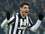 Juventus' forward Alvaro Morata of Spain celebrates after scoring during an Italian Serie A football match Juventus vs. AC Milan at the Juventus Stadium in Turin on February 7, 2015