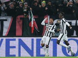 Juventus' Argentinian forward Alberto Carlos Tevez celebrates after scoring on February 7, 2015