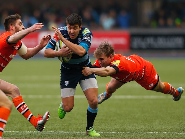 Lucas Amorosino of Cardiff is tackled by Jack Roberts (R) and Owen Williams (L) of Leicester during the LV= Cup match between Cardiff Blues and Leicester Tigers on February 7, 2015