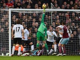 David De Gea of Manchester United makes a save from Enner Valencia of West Ham during the Barclays Premier League match between West Ham United and Manchester United at Boleyn Ground on February 8, 2015