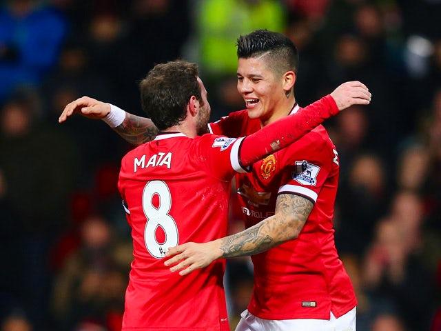 Juan Mata of Manchester United congratulates Marcos Rojo of ...