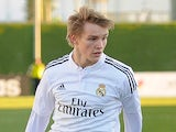 Martin Odegaard of Real Madrid Castilla takes on two Athletic Club B players during the Segunda Division B match against Athletic Club B on February 8, 2015