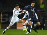 Lyon's French midfielder Maxime Gonalons (L) vies with Paris Saint-Germain's Swedish midfielder Zlatan Ibrahimovic (R) during the French L1 football match on February 8, 2015