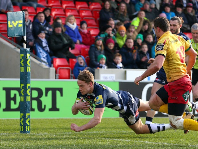Michael Haley of Sale Sharks crosses the line to score a try during the LV Cup match between Sale Sharks and Scarlets at the AJ Bell stadium on February 7, 2015