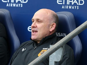 Hull City Assistant Manager Mike Phelan looks on prior to the Barclays Premier League match between Manchester City and Hull City at the Etihad Stadium on February 7, 2015