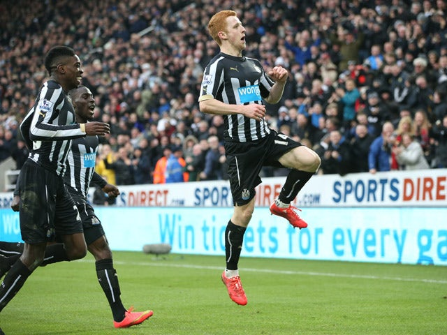 Newcastle United's English midfielder Jack Colback celebrates with Newcastle United's English striker Sammy Ameobi and Newcastle United's French defender Massadio Haidara after he scores the opening goal of the English Premier League football match betwee